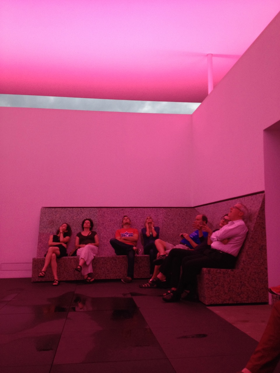 Inside, visitors take in the subtlety changing light installation.