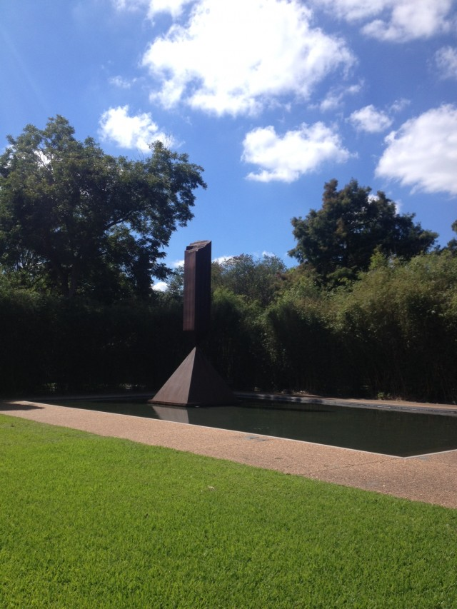 "Barnett Newman's ""Broken Obelisk"" in a reflecting pool outside of the Rothko Chapel"