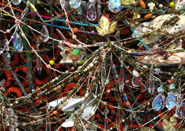 Nick Cave, detail of the large-scale wall based bas reliefs dripping with crystals, beads and metal flowers.