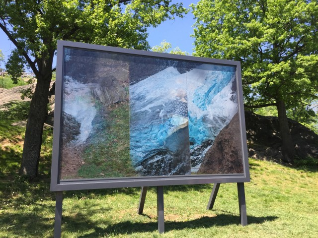 Karyn Oliver 'Here and Now/Glacier, Shar, Rock is a sculptural lenticular billboard adjacent to the Harlem Meer that invokes and blends contrasting topographuc and anthropological histories of Central Park through shifting images of a glacier, a Seneca Village pottery shard, and rocks.